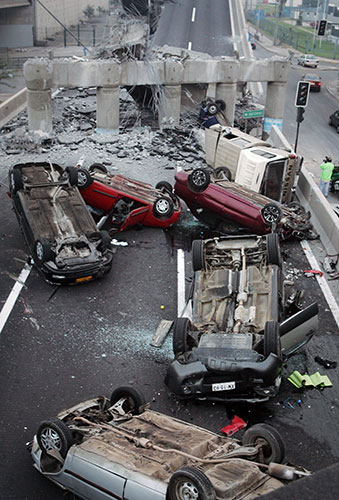 Chile Earthquake: Vehicles on a highway that collapsed during the earthquake near Santiago