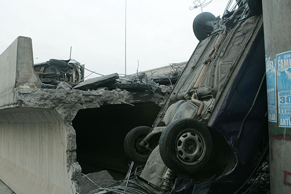 Chile Earthquake: An overturned vehicle in the concrete of a highway that collapsed