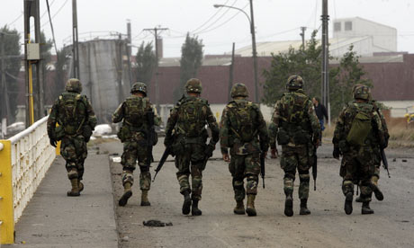 Chilean military takes control of quake hit cities Soldiers guard the street 001