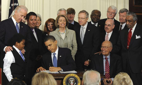 President Obama signing healthcare reform law