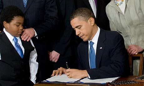 Barack Obama signs healthcare bill