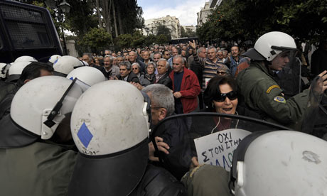 Greek pensioners protest outside Prime Minister's office in Athens