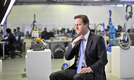 08/03/10b: David Cameron prepares for a TV interview at the Dyson factory.
