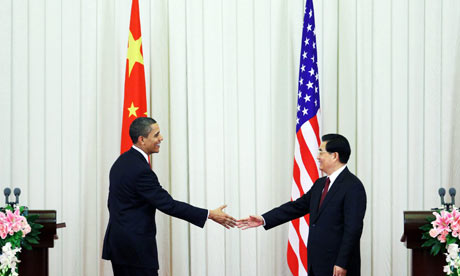 Barack Obama shakes hands with Hu Jintao during his visit to China in November