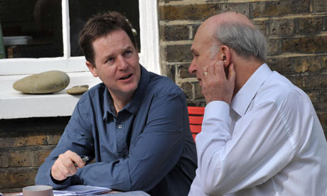 Nick Clegg and Vincent Cable work on the Liberal Democrat manifesto at Clegg's home in Putney