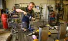 Nigel Tyas, blacksmith, in his workshop in the Pennines, making fine ironwork.