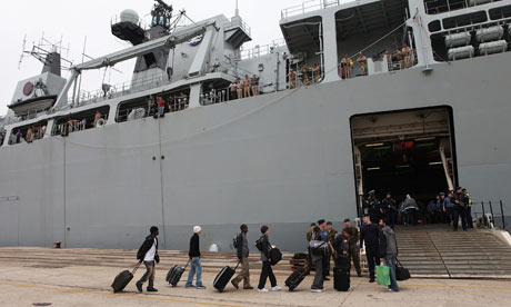 British passengers board HMS Albion at Santander port in Spain.