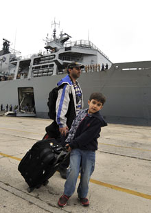 A British family get ready to board the Royal Navy warship HMS Albion at Santander's port, Spain.
