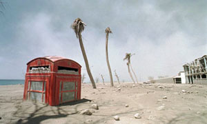 A phone booth lies half-buried in volanic ash after the eruption on Montserrat, 1998.