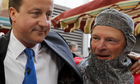 David Cameron poses with a man dressed as English knight during St George's Day celebrations