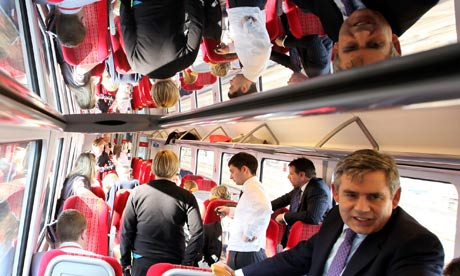 Gordon Brown speaks to journalists on a train to London on 26 April 2010.