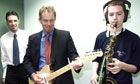 Tony Blair accompanies a young saxophonist on guitar