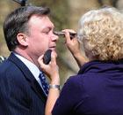 Ed Balls has make-up put on on 6 April 2010.