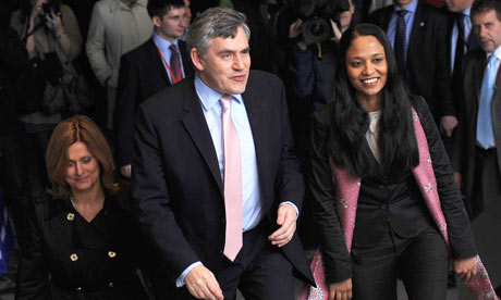 Gordon Brown arriving for a speech in London on 7 April 2010. Also pictured is his wife Sarah (left)