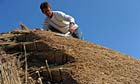 Master thatcher Glen Holloway working on a thatched roof in Frampton, Dorset.