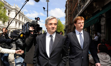 Chris Huhne and Danny Alexander leave the Cabinet Office after talks with the Tories on 10 May 2010.