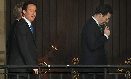 David Cameron and George Osborne walk to a party meeting at parliament