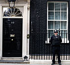 A police officer stands guard outside 10 Downing Street in London.