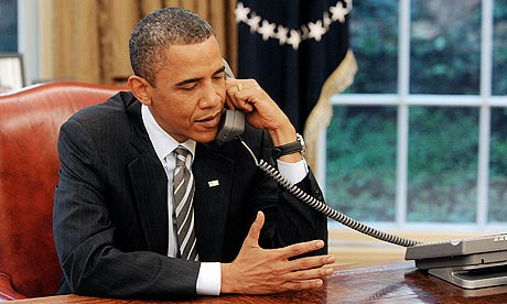 Barack Obama speaking to David Cameron from the Oval Office of the White House