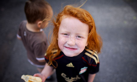 red haired girl eating bread children