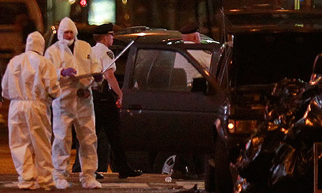 Investigators examine the vehicle in which a bomb was left in New York's Times Square