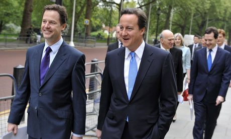 Nick Clegg and David Cameron walk to the Treasury to launch the government's full coalition deal