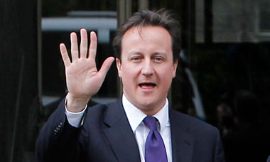 David Cameron waves