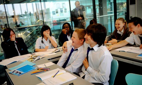 Pupils pose as they are photographed at Bexley Business Academy, formerly Riverside school, London.