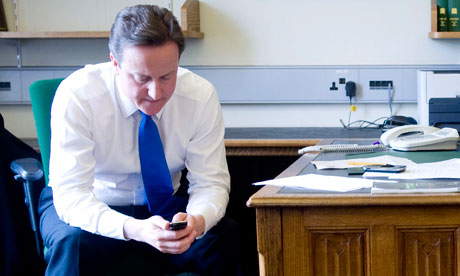 David Cameron texting on his mobile in Portcullis House in London on 11 May 2010.