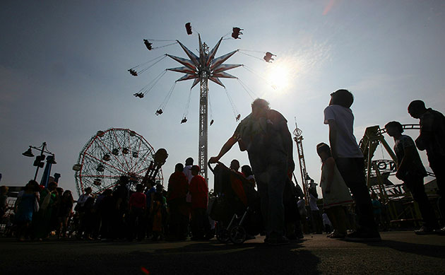 24 hours in pictures: New York, US: People gather on opening day of Luna Park amusement area