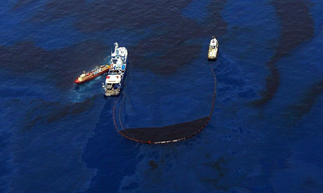 Salvage vessels skim and collect oil near the site of the Deepwater Horizon spill