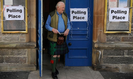 Voter leaves a polling station in Pitlochry, Scotland