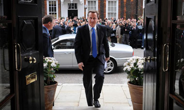 David Cameron arrives at St Stephen&#39;s Club in central London to give his press conference 