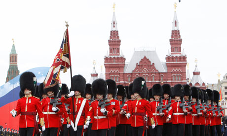 British military personnel march along Red Square during a military parade dress rehearsal in Moscow