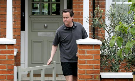 David Cameron leaves his west London home for a run