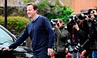 Britain's Conservative party leader Cameron leaves his home in west London