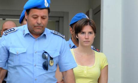 amanda knox images. Amanda Knox is escorted by