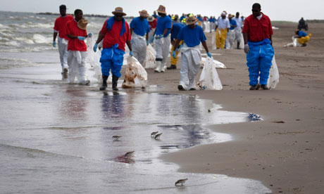 BP workers search beach for oil debris