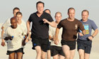 David Cameron goes for a run with British soldiers during his visit to Afghanistan on 11 June 2010