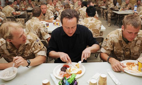 David Cameron eats breakfast with British forces at Camp Bastion, Afghanistan, on 11 June 2010.