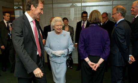 Gus O'Donnell, the cabinet Secretary, accompanies the Queen as she meets civil servants 11 June 2010