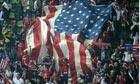 US supporters display a giant flag in th