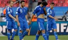 Greek players leave the pitch after South Korea defeat in 2010 World Cup
