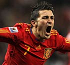 David Villa celebrates his goal for Spain against Portugal