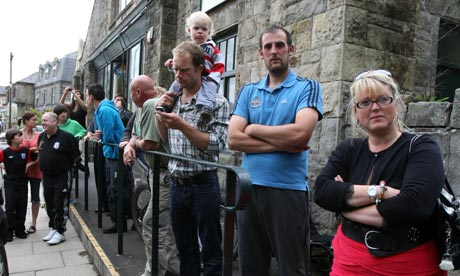 Onlookers in Rothbury during the police operation to find Raoul Moat