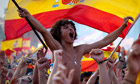Fans celebrate in Barcelona with a rare mass display of Spanish national flags