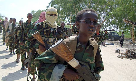 A young boy leads al-Shabab fighters on military exercise in northern Mogadishu, Somalia
