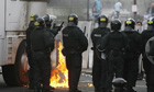 Police clash with nationalist protesters in Ardoyne road area of north Belfast.