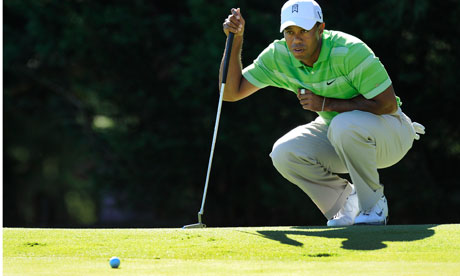 Tiger Woods reads the green.