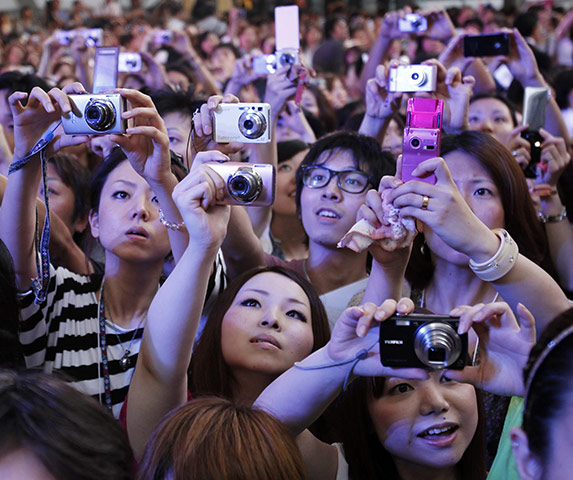 24 hours in pictures: Tokyo, Japan: Fans take photos of celebrities